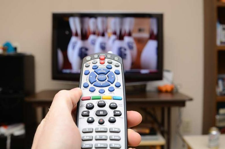 remote-control-in-hand-infront-of-tv